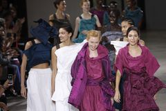 Models walk the runway finale during the Issey Miyake show as part of Paris Fashion Week Womenswear Spring/Summer 2019. PARIS, FRANCE - SEPTEMBER 28: Models walk stock images