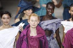Models walk the runway finale during the Issey Miyake show as part of Paris Fashion Week Womenswear Spring/Summer 2019. PARIS, FRANCE - SEPTEMBER 28: Models walk stock image