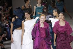 Models walk the runway finale during the Issey Miyake show as part of Paris Fashion Week Womenswear Spring/Summer 2019. PARIS, FRANCE - SEPTEMBER 28: Models walk stock photo