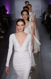 Models walk runway at Jim Hjelm fashion show during Fall 2015 Bridal Collection Stock Photography