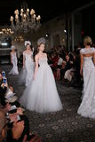 Models walk the runway at the Mira Zwillinger Spring 2015 Bridal collection show Stock Images