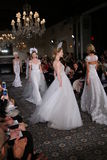 Models walk the runway at the Mira Zwillinger Spring 2015 Bridal collection show Stock Photos