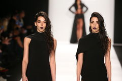 Models walk the runway in a MT Costello design at the Art Hearts Fashion show during MBFW Fall 2015 Stock Images