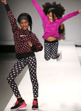 Models walk the runway at the Nike Levi's Kids fashion show during Mercedes-Benz Fashion Week Fall 2015. NEW YORK, NY - FEBRUARY 12: Models walk the runway at Royalty Free Stock Images