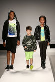 Models walk the runway at the Nike Levi's Kids fashion show during Mercedes-Benz Fashion Week Fall 2015. NEW YORK, NY - FEBRUARY 12: Models walk the runway at Stock Images