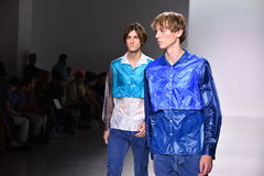 Models walk the runway at the Patrik Ervell show. NEW YORK, NY - JULY 11: Models walk the runway at the Patrik Ervell show during NYFW: Mens July 2017 at Royalty Free Stock Photography