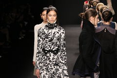 Models walk the runway at the Vivienne Tam fashion show during Mercedes-Benz Fashion Week Fall 2015. NEW YORK, NY - FEBRUARY 16: Models walk the runway at the royalty free stock photography