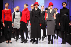 Models in wear from UNQ standing on catwalk Stock Images