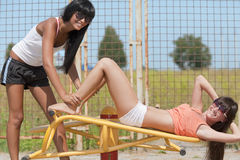 Models working out on fitness playground Stock Photos