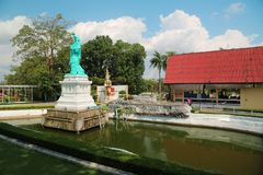 Models of world attractions in Mini Siam park in Pattaya, Thailand. THAILAND, PATTAYA, APRIL 7, 2014: Statue of Liberty and models of world attractions in Mini royalty free stock photography