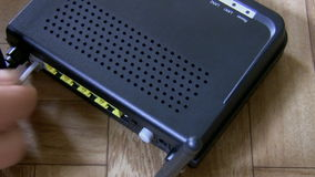 Modem, cable plugging top view stock footage