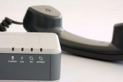 Modem e microtelefono di DSL fotografie stock