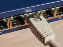 Modem router switch with RJ45 ethernet plug ports. Modem router switch with ports for RJ45 plug in LAN local area network ethernet connection Royalty Free Stock Photos