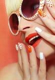 Modemakeup och orange färg för manikyr royaltyfria foton