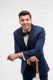 Modemann mit Stockregenschirm Stockfoto