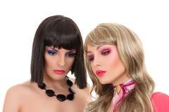 Modemodell för två barn som poserar som Royaltyfri Bild