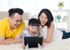 Moden lifestyle of asian family. Asian family having fun with tablet computer Royalty Free Stock Image