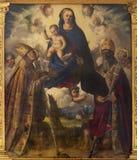 MODENA, ITALIË - APRIL 14, 2018: Het schilderen van Madonna met st Matin en St Geminianus in Di San Pietro van kerkabazzia royalty-vrije stock foto's