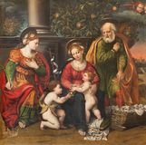 MODENA ITALIEN - APRIL 14, 2018: Målningen av den heliga familjen och St John det baptistiskt i kyrkliga Chiesa di San Pietro arkivbilder