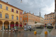 MODENA, ITALY: colorful city center buildings on a rainy day. Modena, Italy - Emilia-Romagna region. Colorful Mediterranean architecture as can be seen on royalty free stock images