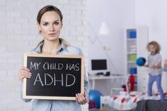 Moder av barnet med ADHD royaltyfria bilder