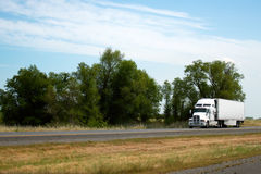 Moder bonnet white big rig semi truck with reefer trailer delive Stock Photography