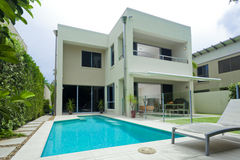 Moder house with swimming pool. Modern, minimalist, multilevel house with swimming pool Stock Images
