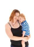 Moder med hennes ledsna pys Arkivbild