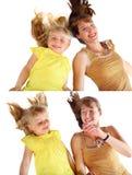 Moder och dotterleendet Royaltyfri Bild