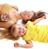 Moder och dotterleendet Royaltyfria Bilder