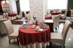 Moder restaurant interior. Modern restaurant interios, tables set for dinner Stock Image