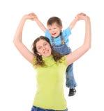 Moder som rymmer hennes son i händer arkivfoton