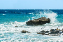 Moderate sea waves hitting the rocks Stock Photos