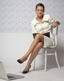 Moderate skepticism. Girl in a light jacket, sitting on white chair royalty free stock photos