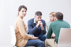 Moderating a discussion about drug addiction. Shot of a young women taking part in a meeting of a support group Stock Images
