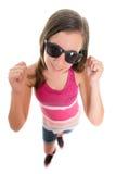 Moderiktig tonårs- flicka som ler och lyfter hennes armar som isoleras på vit Fotografering för Bildbyråer
