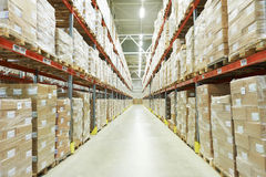 Moderm warehouse. Interior of warehouse. Rows of shelves with boxes Royalty Free Stock Photo