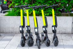 Modern сity transport - Five electric scooters are parked on the street of the city.  stock images