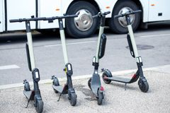 Modern сity transport - Four electric scooters is parked on the street of the city.  stock photography