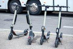 Modern сity transport - Four electric scooters is parked on the street of the city.  royalty free stock images