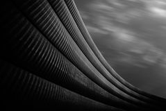 Modern abstract architectural shapes on the grey sky background.  Royalty Free Stock Image
