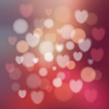 Modern abstract glow colorful background with hearts, bokeh effect,  Royalty Free Stock Image