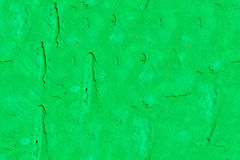 Bright green stone wall. Modern abstract painted bright green street stone wall, seamless texture Royalty Free Stock Image