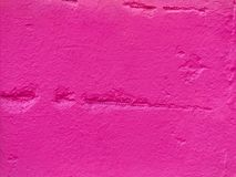 Pink stone wall. Modern abstract painted pink street stone wall Stock Image