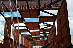 Modern abstract structure  in aluminium and wood. Interesting frame structure composed of semi transparent brown panels and wooden beams and columns combined Stock Images