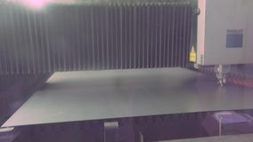 Modern accurate laser cnc metal cutting in a closed box. Cutting metal at the plant, cutting metal at the plant CNC machine in a closed box stock footage