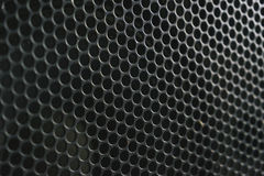Modern acoustic systems. Metal grating on the sound dynamics. Abstraction and background. Soft focus and beautiful light royalty free stock photography