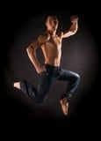 Modern acrobat jumping Stock Images