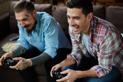 Modern Adult Men in Video Game Battle Stock Image