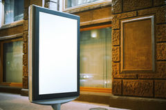 Modern advertising stand near old building Stock Images